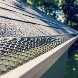 Gutter screens and micro-mesh covers shown on a home.