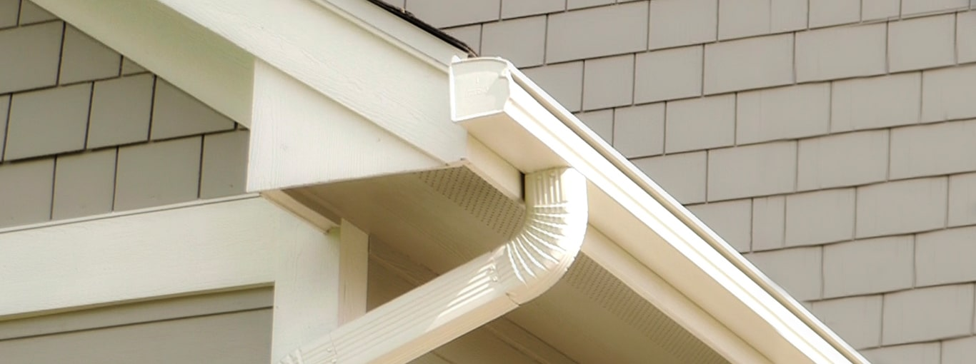 LeafGuard gutters shown on a home in New England
